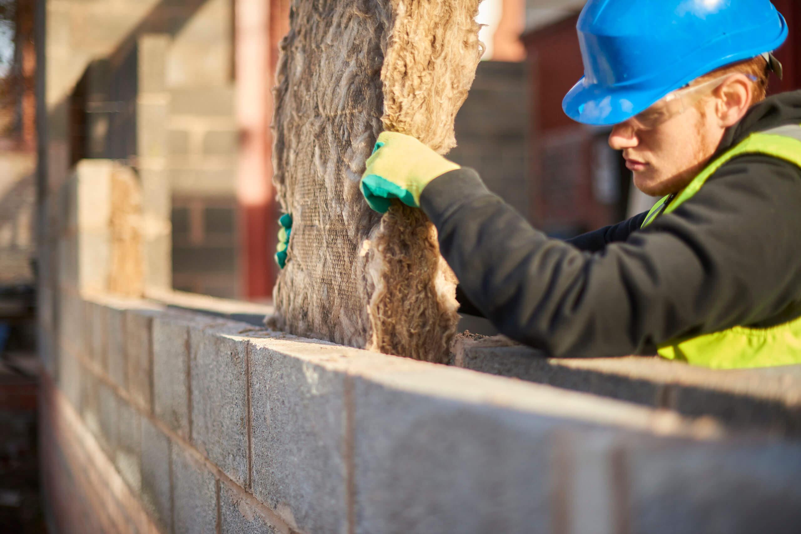 Man installing cavity wall insulation
